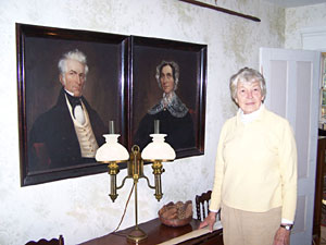 Mystery author Cynthia Riggs stands in the front hall of her ancestral home.